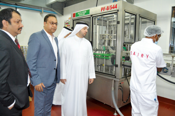 Al Mazrouei and other dignitaries visiting the new Delta dairy plant in Saif Zone