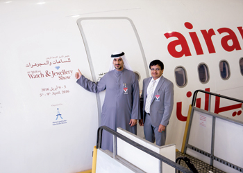 Al Midfa points to the branding of the 40th MidEast Watch and Jewellery Show on an Air Arabia aircra